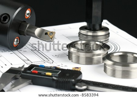 Measuring metal components - stock photo