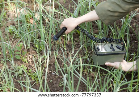 Measuring radiation levels of vegetables - stock photo