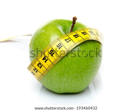 Measuring tape around a green apple, isolated on white - stock photo