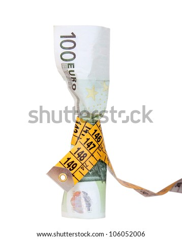 measuring tape around a hundred euro banknote - stock photo
