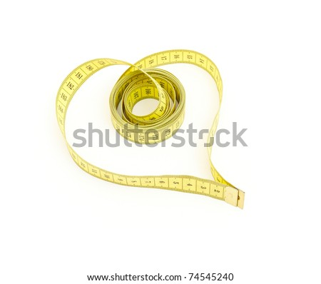 Measuring tape looking as heart over white background - stock photo