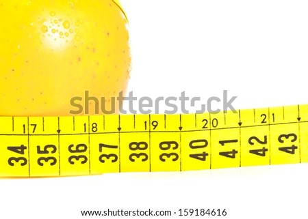 measuring tape near wet apple on white background