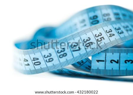 Measuring tape of the tailor - macro - stock photo