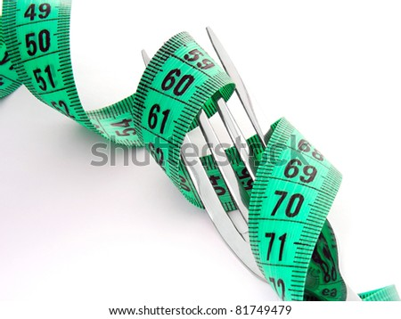 Measuring tape on a fork. Healthy life concept.