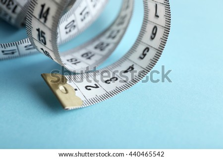 Measuring tape  on blue background