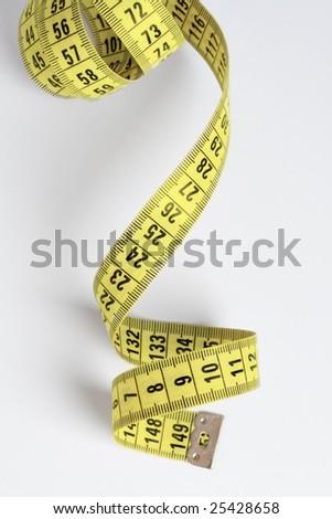 measuring tape on light background - stock photo