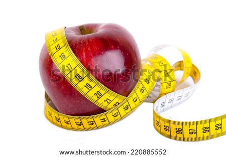 Measuring tape wrapped around a apple weight loss isolated on white photo - stock photo