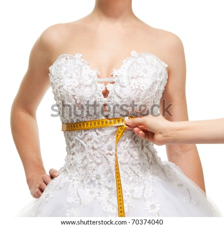 Measuring woman's waist under the breast with centimeter, isolated on white - stock photo