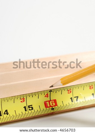 measuring wood to cut