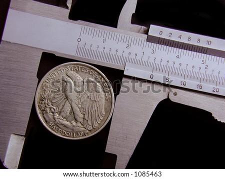 Measuring your money, literally. Walking Liberty Half Dollar - stock photo