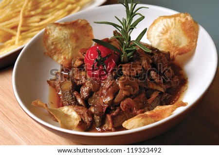 meat and mushroom with chips