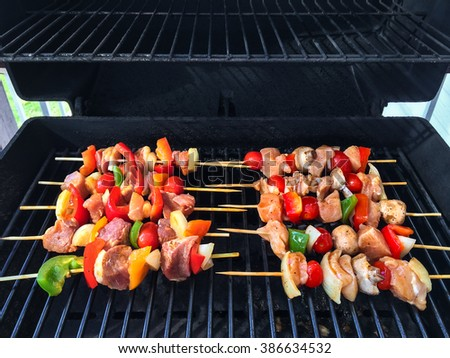 Meat and vegetable skewers on a barbecue grill. Summer bbq.