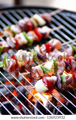 Meat and vegetables on grill - stock photo