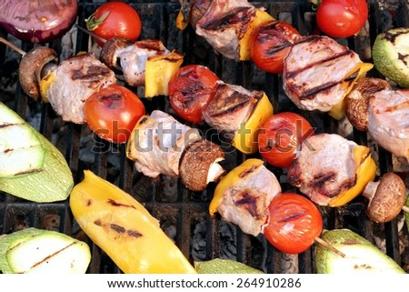 Meat And Vegetables Shish Kabobs On The Charcoal Grill Close-up Background - stock photo