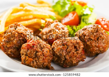meat balls with fries and salad