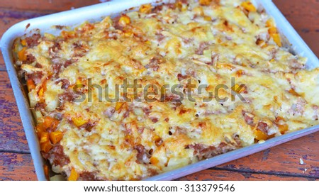 meat casserole with cheese on a baking sheet - stock photo