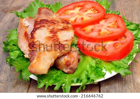 meat chops with tomatoes in a bowl - stock photo
