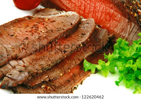 meat chunk and green lettuce on white