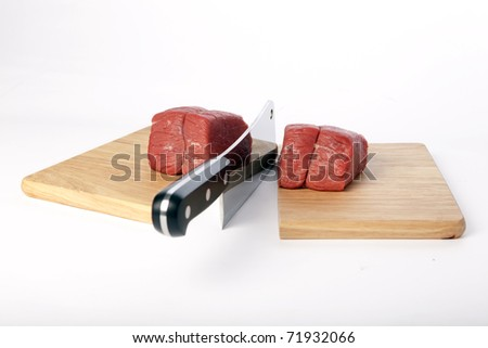 Meat cleaver chopping board. - stock photo