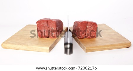 Meat cleaver chopping board - stock photo