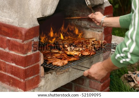 meat cooking on barbeque grill - stock photo