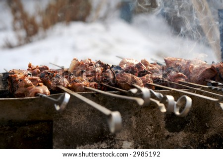 meat cooking on fire