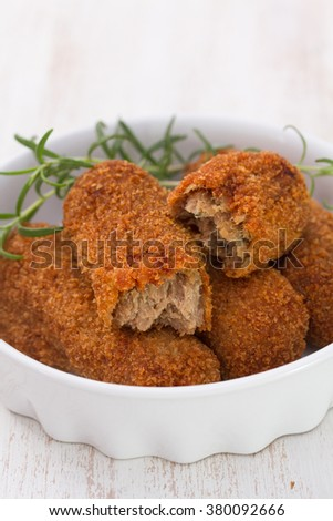 meat croquettes in white dish on white background