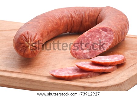 Meat delicatessen on the board isolated on the white