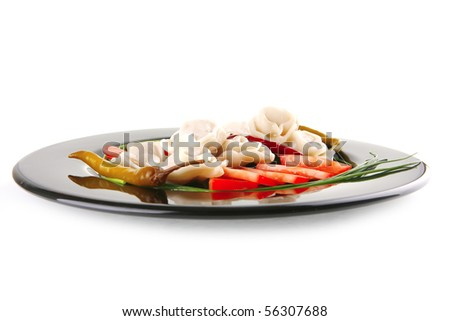 meat dumplings served on black plate with chives - stock photo