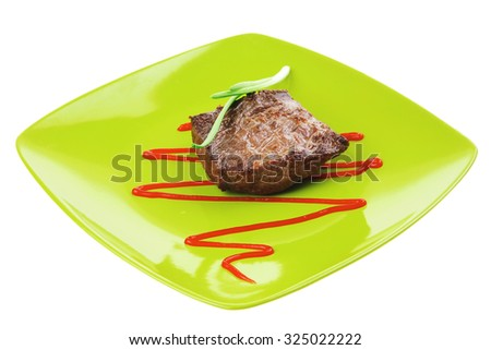 meat food : roast beef fillet mignon served on green plate with chives and ketchup isolated over white background - stock photo