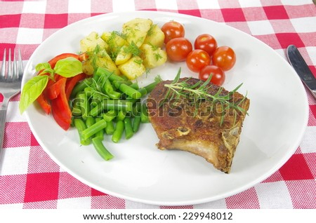 meat from grill with vegetables on plate - stock photo