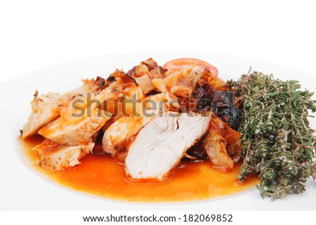 meat grilled chicken fillet with salad and tomatoes on white plate isolated over white background - stock photo
