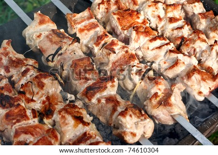 Meat, grilled over charcoal (barbecue over charcoal). - stock photo