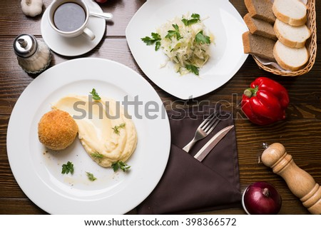 Meat in Breadcrumbs, Cabbage Salad And Cup of Coffee On A Table - stock photo