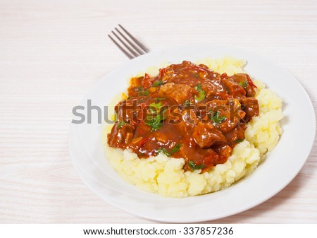 meat in sauce with mashed potatoes - stock photo