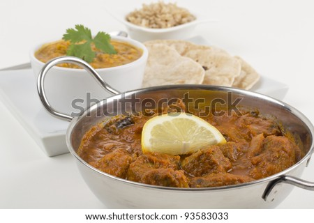 Meat Madras served with pilau rice, tadka dahl and chapatis - stock photo