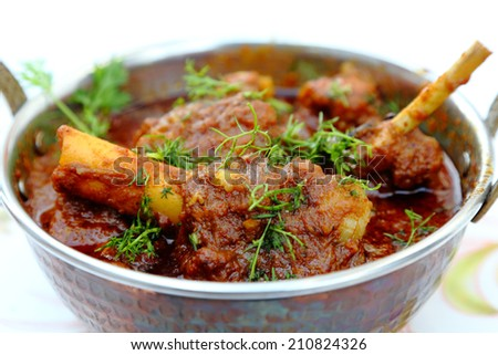 Meat, mutton or chicken curry dish in a copper brass bowl - stock photo