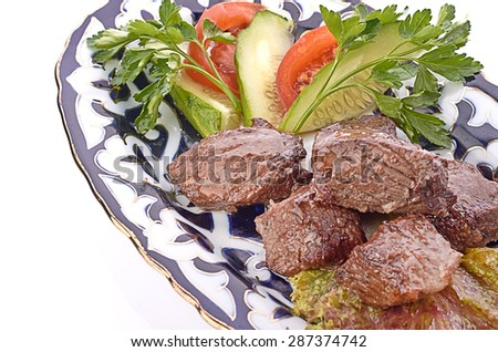 Meat on a grill with vegetables