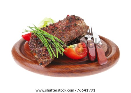 meat over wood: grilled shoulder on plate with tomatoes green lettuce and cutlery isolated on white background - stock photo