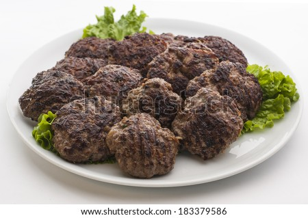 Meat patties in a plate on white background - stock photo