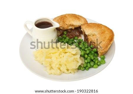 Meat pie, mashed potato and peas with a jug of gravy on a plate isolated against white - stock photo