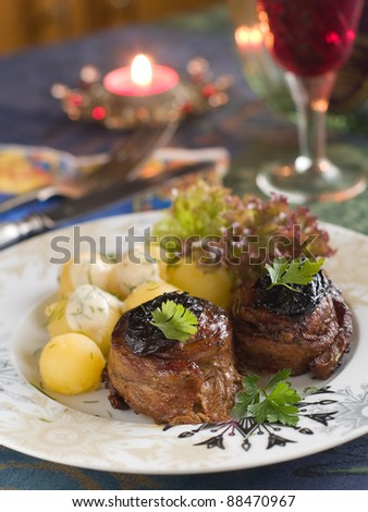 Meat rolls with plum and potatoes. Selective focus - stock photo