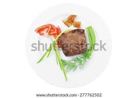 meat savory : grilled beef fillet mignon served on white plate isolated over white background with chili pepper and tomatoes - stock photo