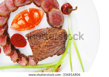 meat savory : roasted bbq meat served on white plate with tomatoes , sprouts and bread isolated on white background - stock photo