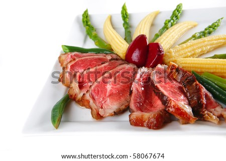 meat served with beans and corns on white dish - stock photo