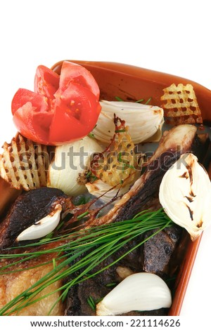 meat served with vegetables over white background - stock photo