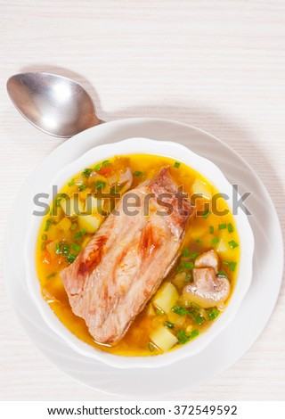 Meat soup with vegetables and mushroom
