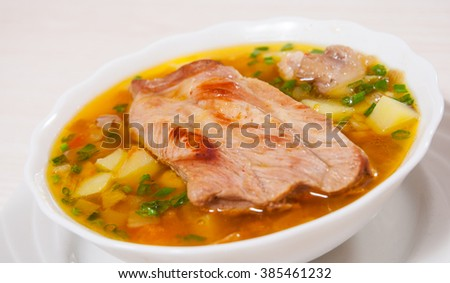 Meat soup with vegetables and mushroom - stock photo