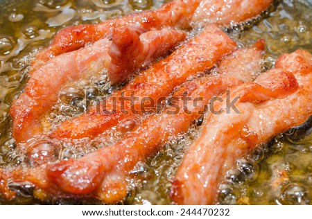 Meat Strips Fried In A Black Pan - stock photo