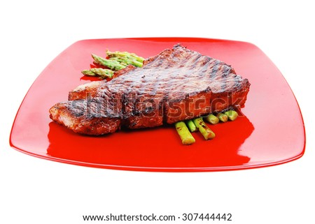 meat table : rare medium roast beef fillet asparagus served on red dish isolated over white - stock photo
